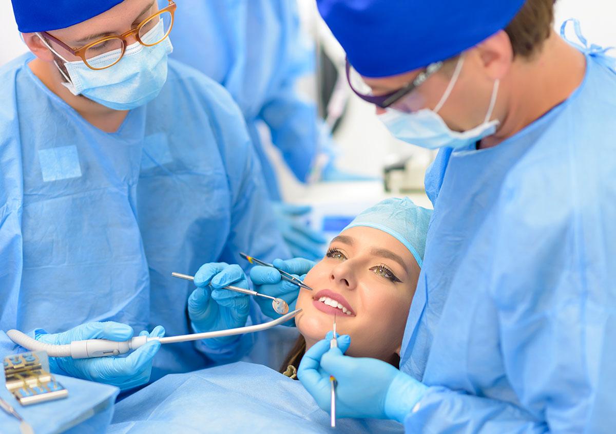 Woman having dental surgery