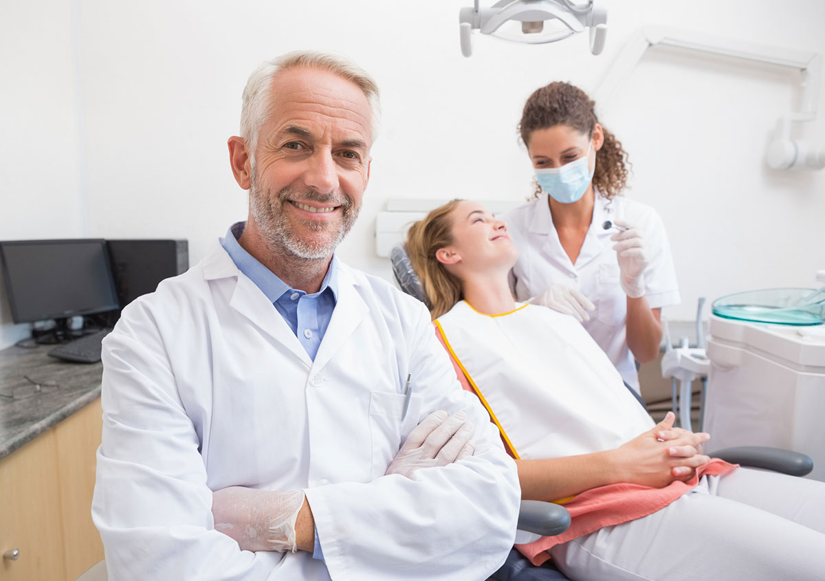 Dentist smiling at the dental