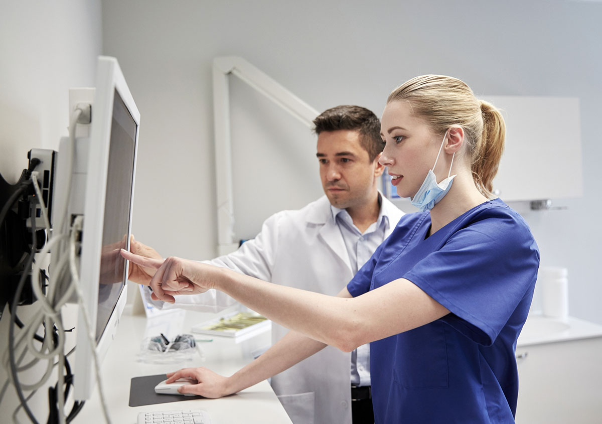 Dentists examining the x ray report